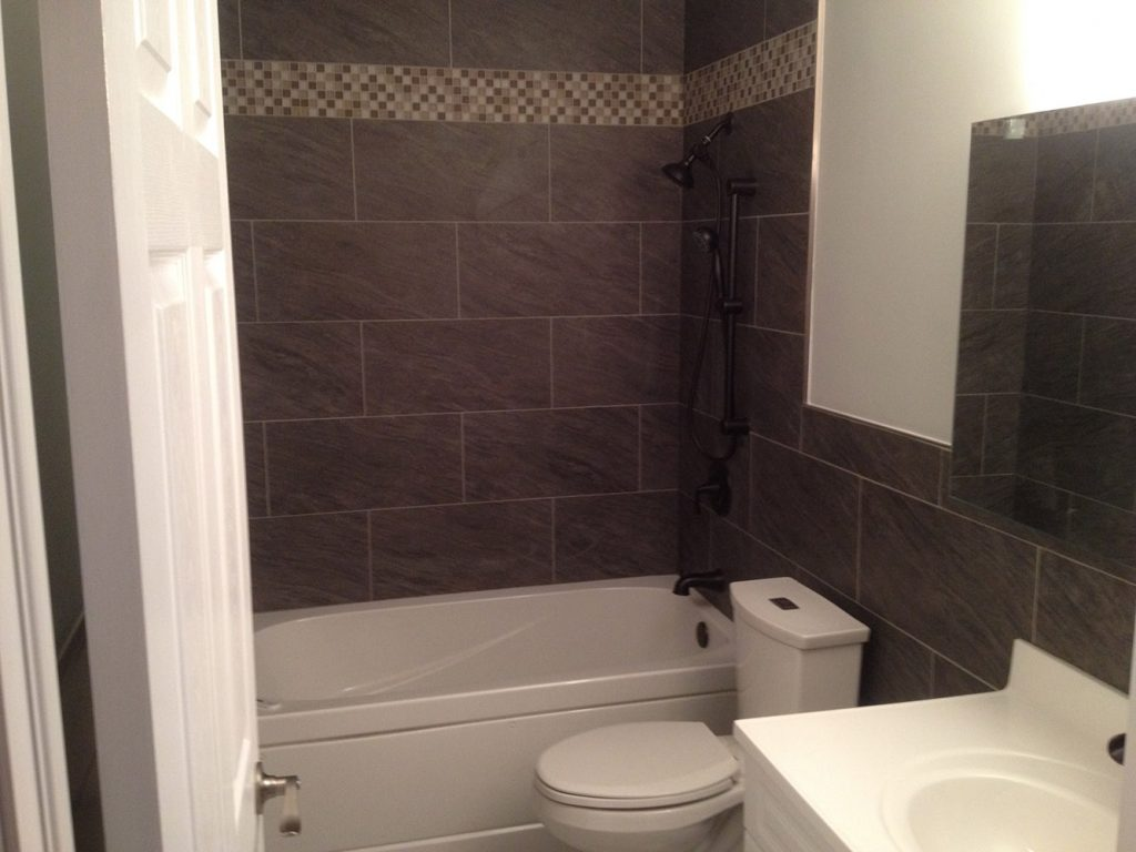 Westmount Accessible Renovation: This project involved removing a bathtub  and replacing it with a walk-in shower. The 'curb' is sloped to allow a  walker to ...
