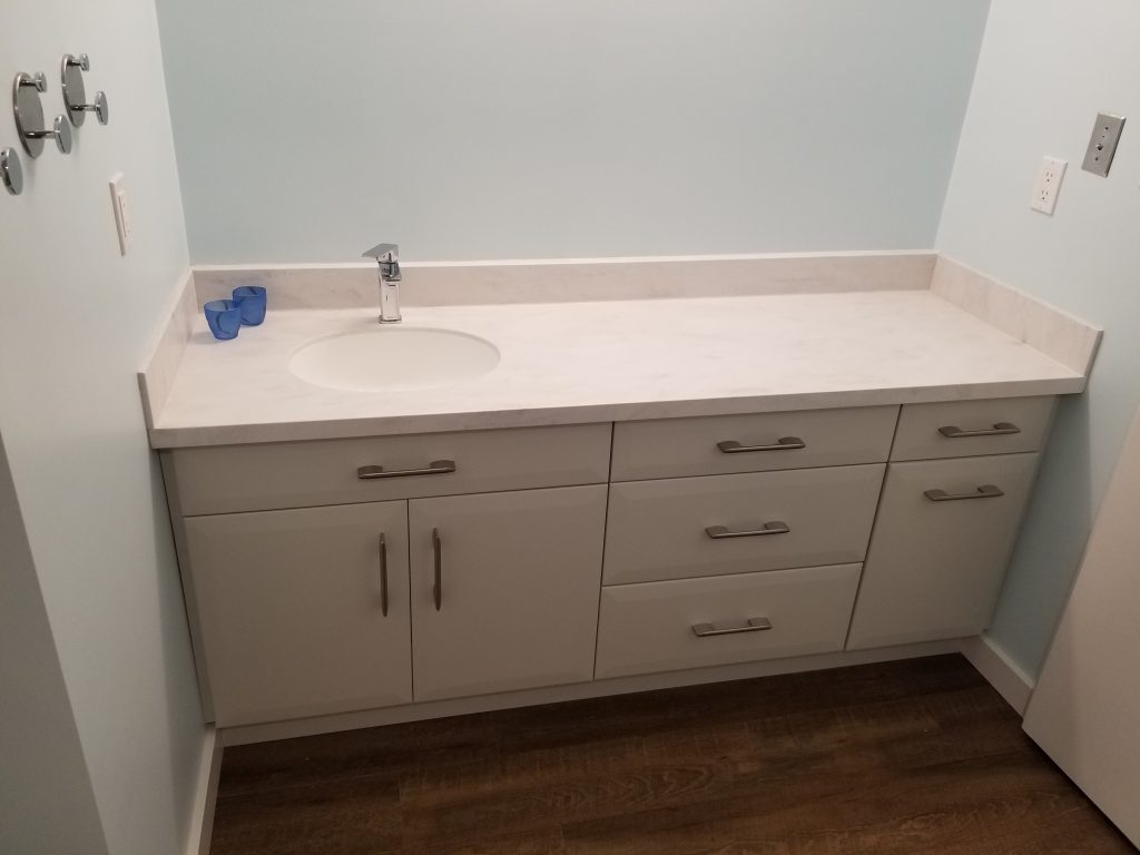 Aging in place bathroom reno vanity with Dorian Grey Corian countertop.