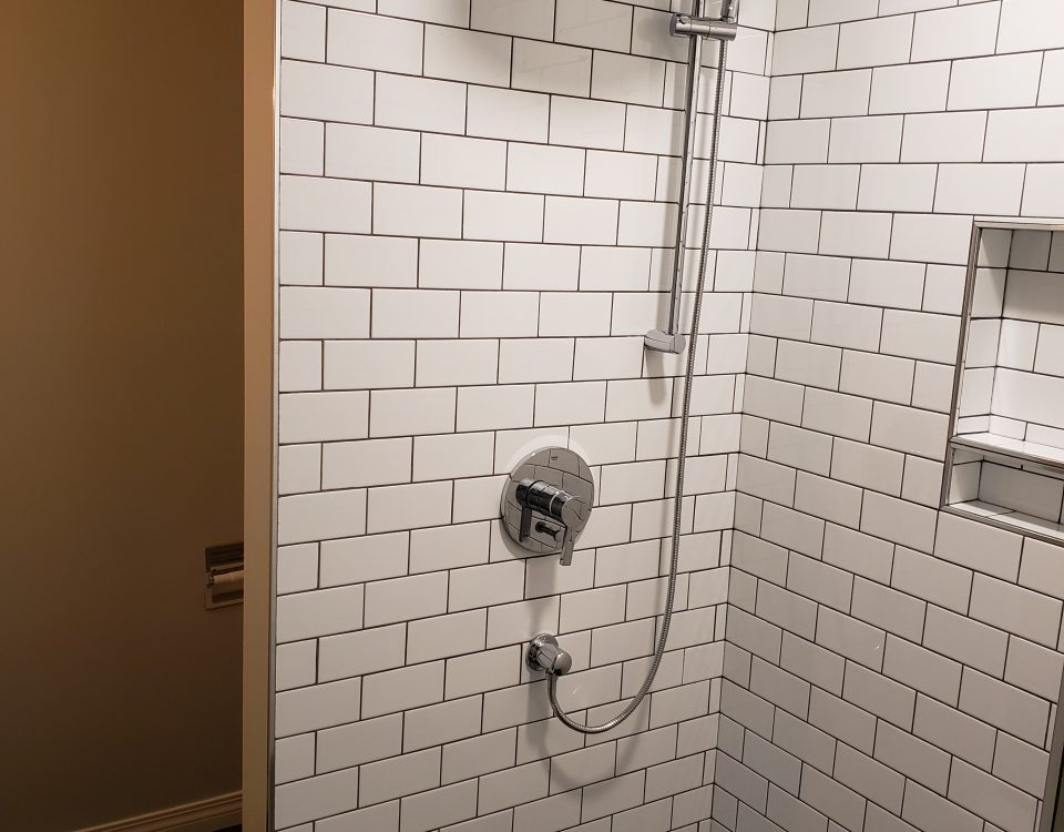 Grohe Lineare dual function rain head and shower arm in chrome to match the other fixtures in the bathroom