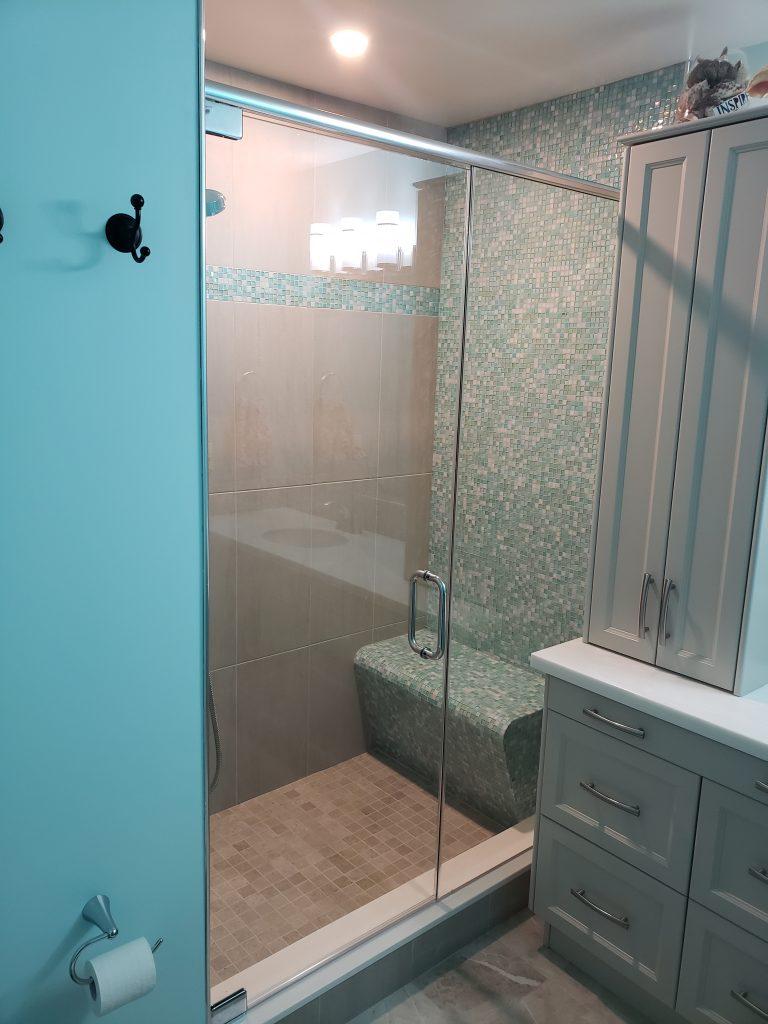 Custom walk-in shower reno with Grohe Lineare shower kit & 10 inch rain head.