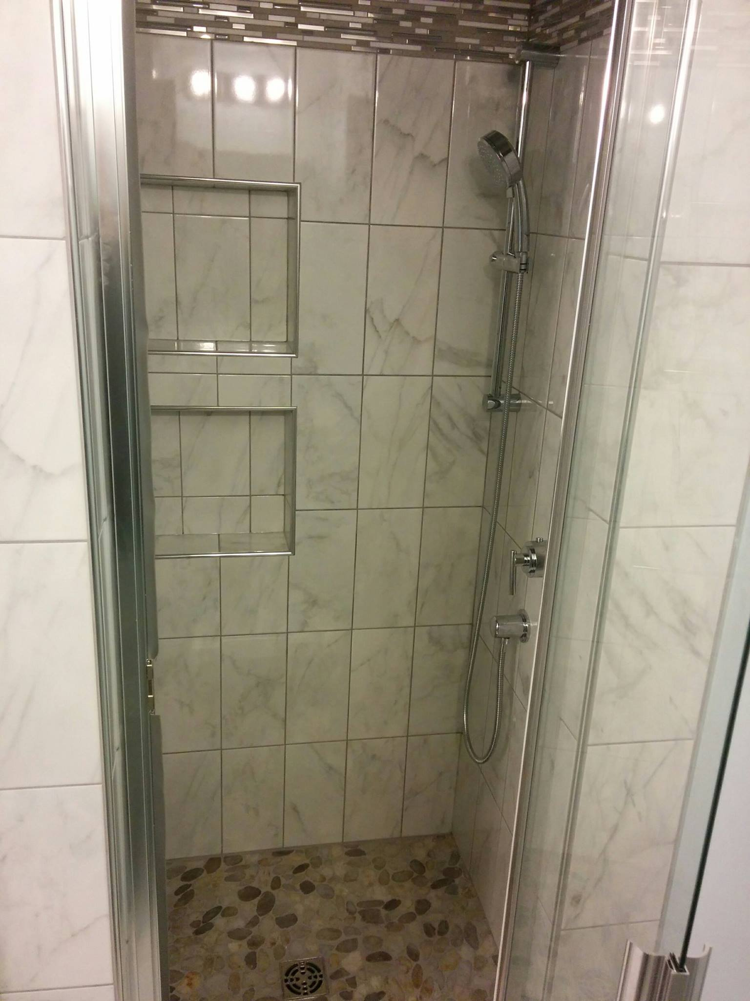 The client chose a Grohe shower trim kit with a rain head for a great showering experience.