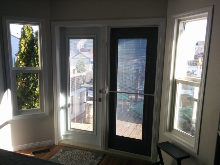 Brand new Wood/ Metal Clad garden door to replace their old one as well as two new windows.