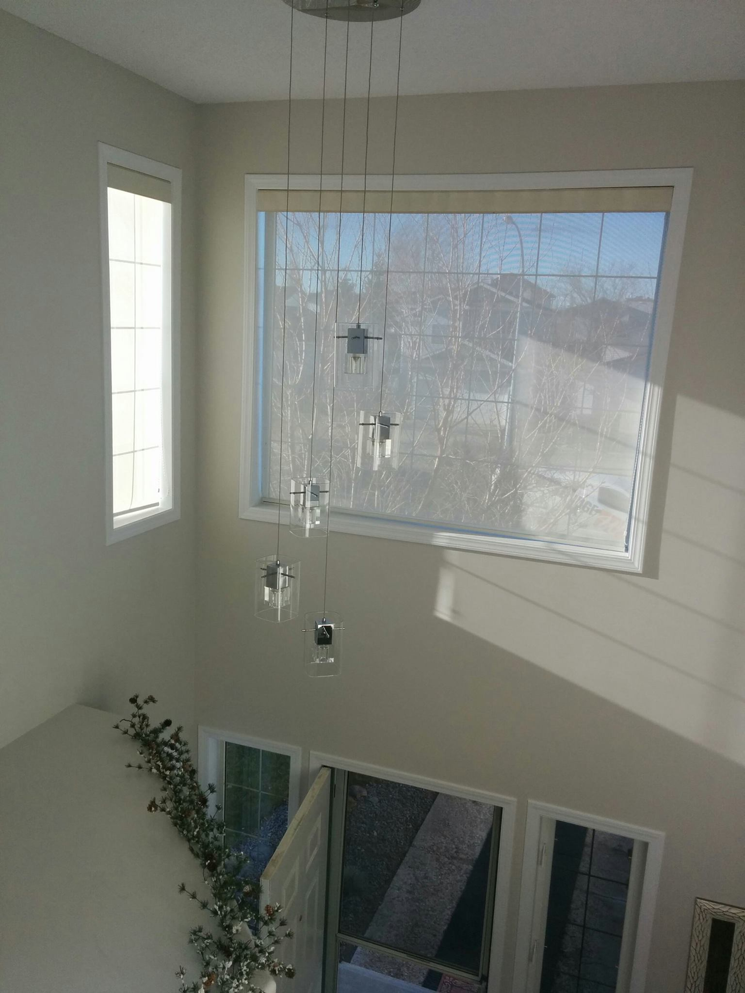 the hard to reach windows were dressed up with new casing and a new chandalier was installed over the front entrance.