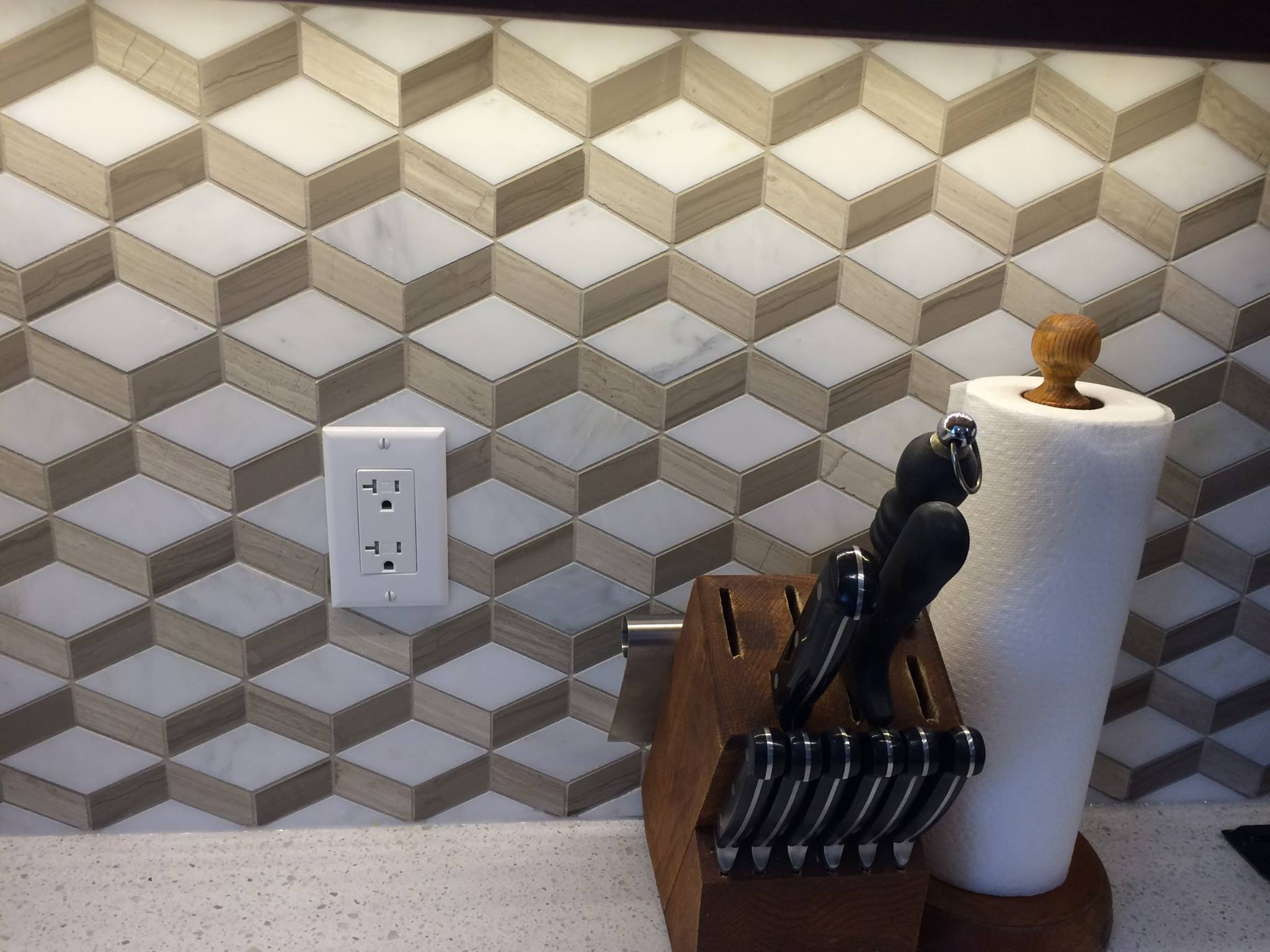 To give the kitchen a bit of pizzazz, the backsplash was done in a tile that gave the impression of a three dimensional backsplash.