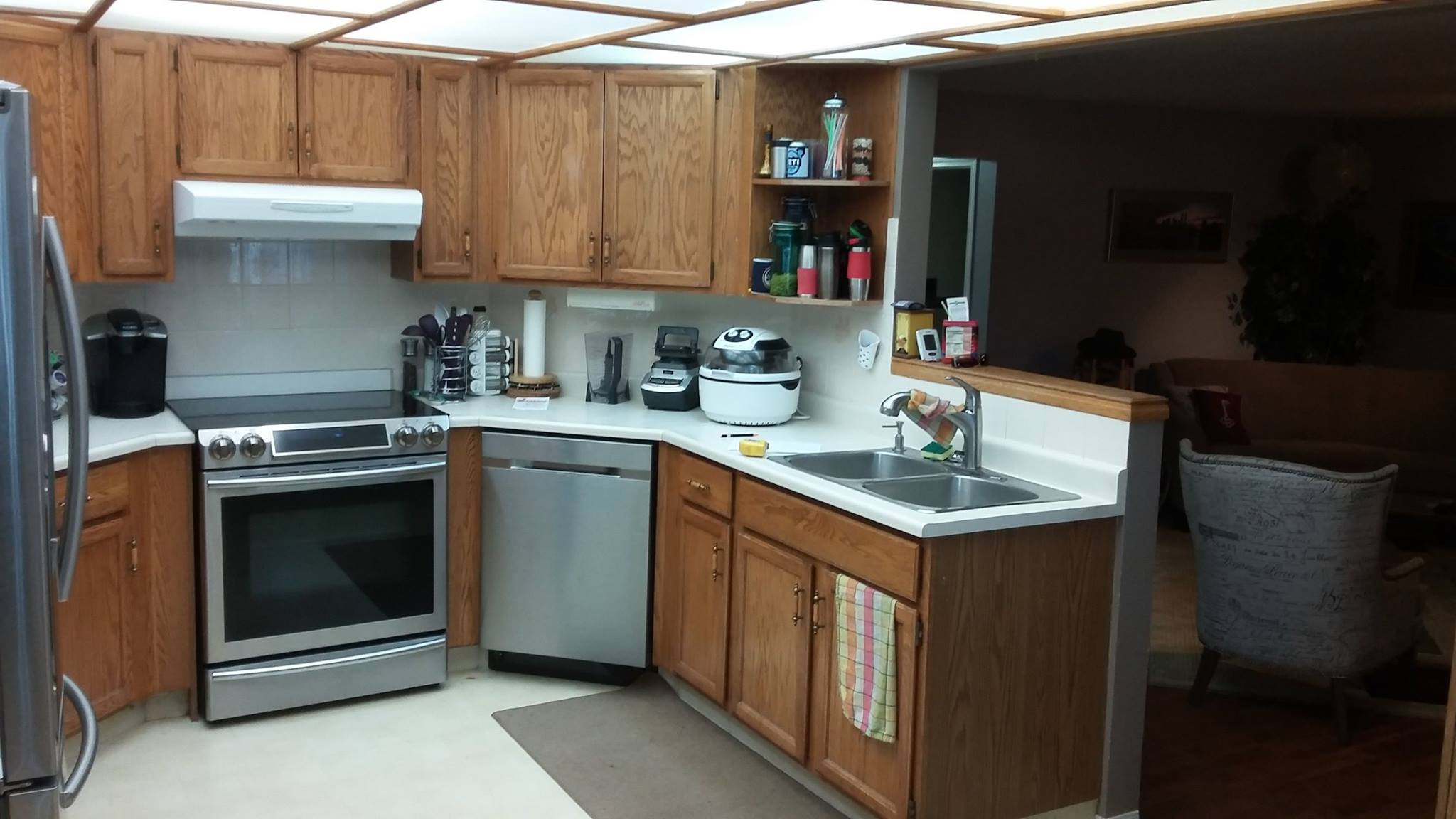 Cut off from the rest of the house, this kitchen doesn't allow the cook to spend time with guests during a family event. As well, that sunshine ceiling with flourescent lighting was an eyesore that had to go.
