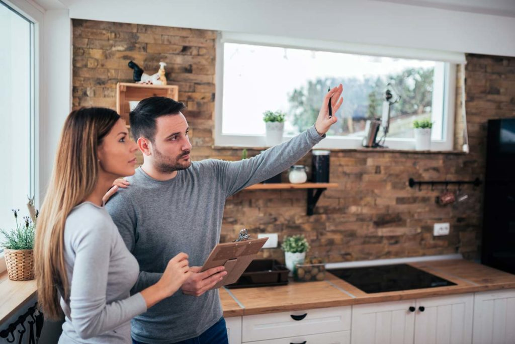 Couple deciding what to consider when renovating a kitchen